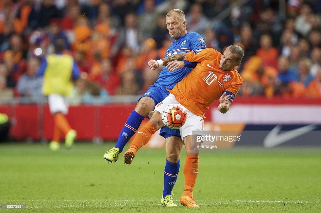 Eider Smari Gudjohnsen of Iceland, Wesley Sneijderof Holland during the UEFA Euro 2016 qualifying match between Netherlands and Iceland on September 3, 2015 at the Amsterdam Arena in Amsterdam, The Netherlands.