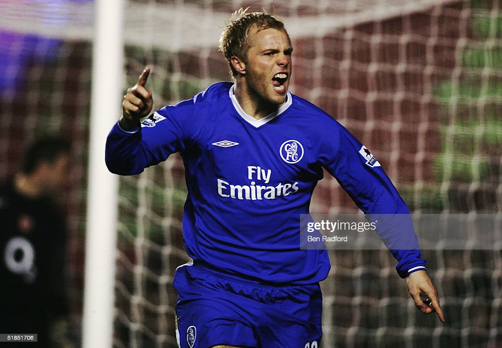 Eidur Gudgjohnsen of Chelsea celebrates scoring their second goal during the Barclays Premiership match between Arsenal and Chelsea at Highbury on December 12, 2004 in London.
