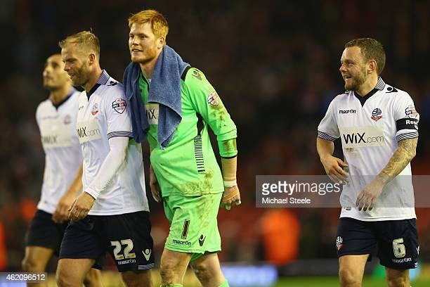 Eidur Gudjohnsen Adam Bogdan and Jay Spearing of Bolton walk towards the travelling suppor to celebrate their sides draw on the final whistle during...