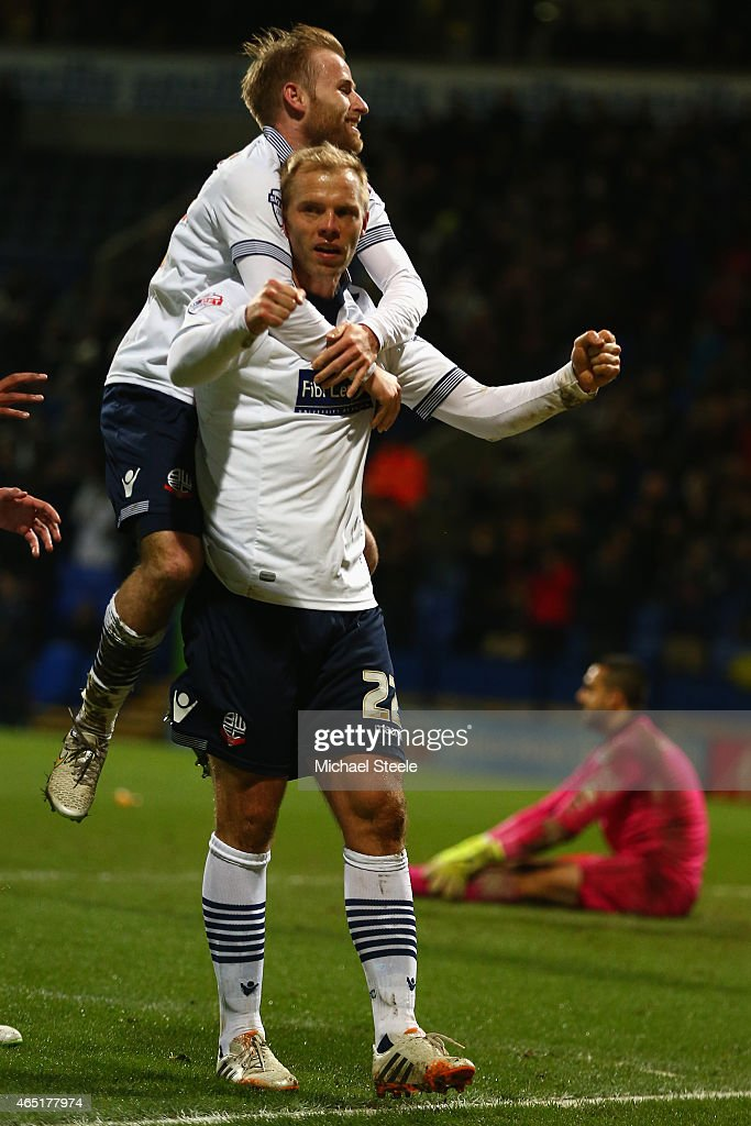 <a gi-track='captionPersonalityLinkClicked' href=/galleries/search?phrase=Eidur+Gudjohnsen&family=editorial&specificpeople=171363 ng-click='$event.stopPropagation()'>Eidur Gudjohnsen</a> of Bolton celebrates with <a gi-track='captionPersonalityLinkClicked' href=/galleries/search?phrase=Barry+Bannan&family=editorial&specificpeople=5449430 ng-click='$event.stopPropagation()'>Barry Bannan</a> after scoring the opening goal during the Sky Bet Championship match between Bolton Wanderers and Reading at Macron Stadium on March 3, 2015 in Bolton, England.