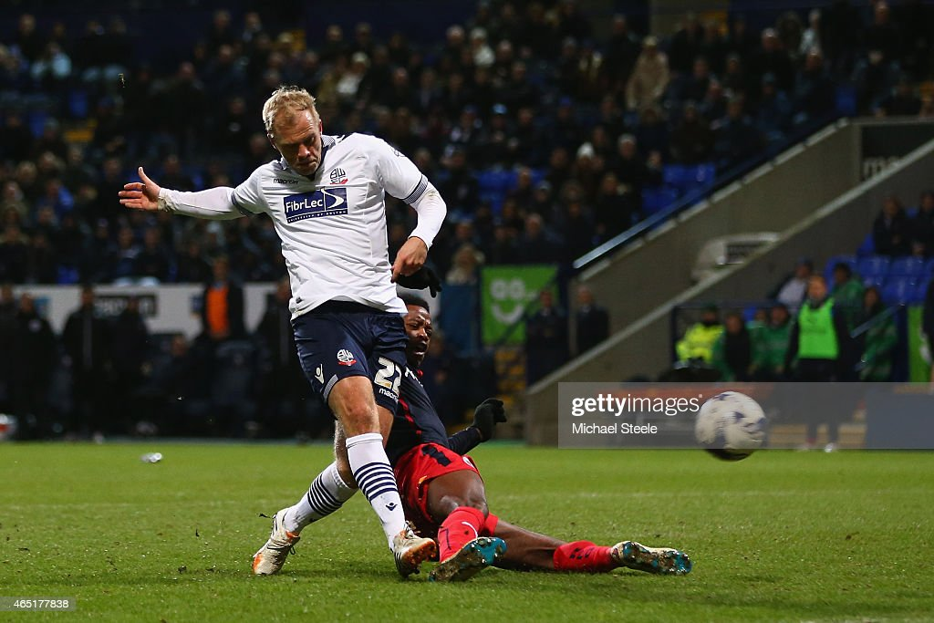 <a gi-track='captionPersonalityLinkClicked' href=/galleries/search?phrase=Eidur+Gudjohnsen&family=editorial&specificpeople=171363 ng-click='$event.stopPropagation()'>Eidur Gudjohnsen</a> of Bolton scores the opening goal during the Sky Bet Championship match between Bolton Wanderers and Reading at Macron Stadium on March 3, 2015 in Bolton, England.