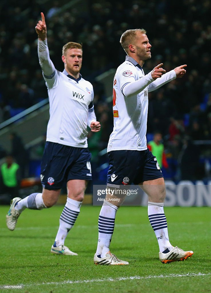 <a gi-track='captionPersonalityLinkClicked' href=/galleries/search?phrase=Eidur+Gudjohnsen&family=editorial&specificpeople=171363 ng-click='$event.stopPropagation()'>Eidur Gudjohnsen</a> of Bolton Wanderers (R) celebrates scoring the opening goal from the penalty spot with <a gi-track='captionPersonalityLinkClicked' href=/galleries/search?phrase=Matt+Mills+-+Soccer+Player&family=editorial&specificpeople=5671936 ng-click='$event.stopPropagation()'>Matt Mills</a> of Bolton Wanderers during the FA Cup Fourth round replay between Bolton Wanderers and Liverpool at Macron Stadium on February 4, 2015 in Bolton, England.