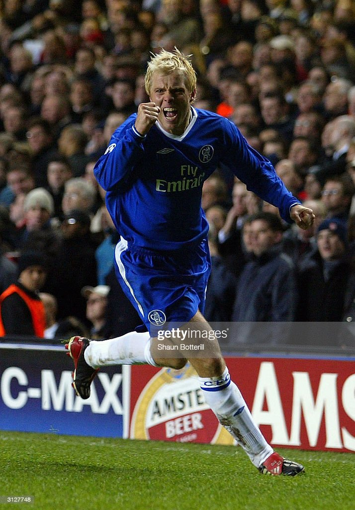 Eidur Gudjohnsen of Chelsea celebrates scoring the first goal for Chelsea during the UEFA Champions League Quarter Final match between Chelsea and Arsenal at Stamford Bridge on March 24, 2004 in London.