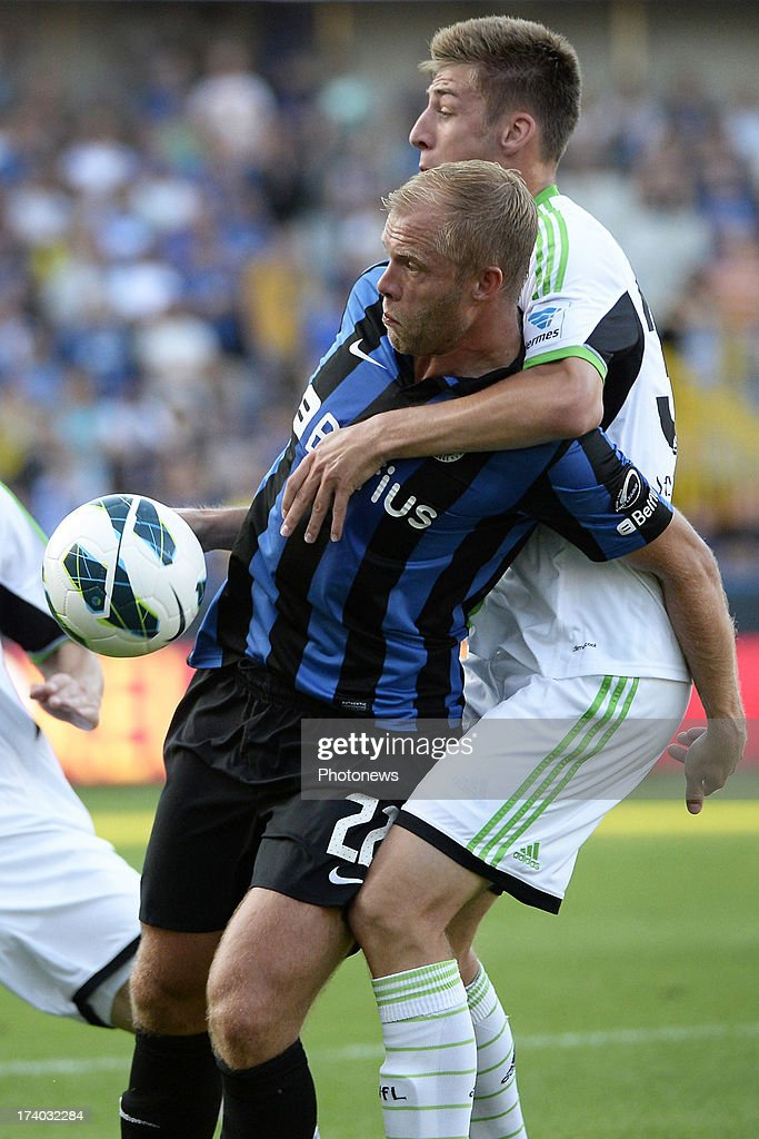 <a gi-track='captionPersonalityLinkClicked' href=/galleries/search?phrase=Eidur+Gudjohnsen&family=editorial&specificpeople=171363 ng-click='$event.stopPropagation()'>Eidur Gudjohnsen</a> of Club Brugge K.V. handles the ball during the friendly match between Club Brugge K.V. and Wolfsburg on July 19, 2013 in Bruges, Belgium.