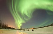 'Eielson Air Force Base, Alaska -- The Aurora Borealis, or Northern Lights, shines above Bear Lake here January 18. The lights are the result of solar particles colliding with gases in Earth's atmosphere. '