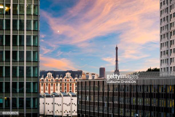 Eiffel tower between skyscraper of financial district of La Défense, Paris, France