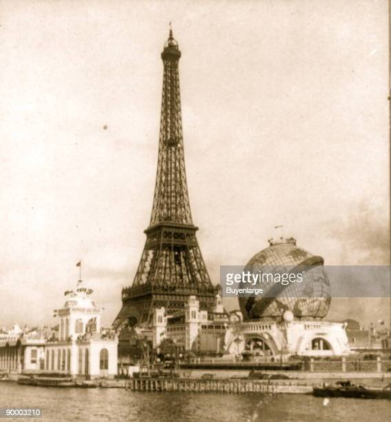 Eiffel Tower in middle from right bank of the Seine The Exposition Universelle of 1900 was a world's fair held in Paris France to celebrate the...