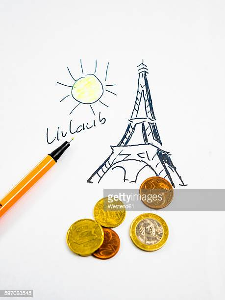 Eiffel tower in Paris, holidays, drawn, coins, symbolical picture
