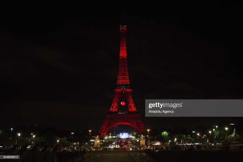 Eiffel Tower is illuminated with the colors of the Turkish national flag to honor the victims of the recent terrorist attack at Istanbul Ataturk Airport, on July 1, 2016 in Paris, France.