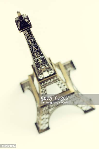 Eiffel Tower model over white background