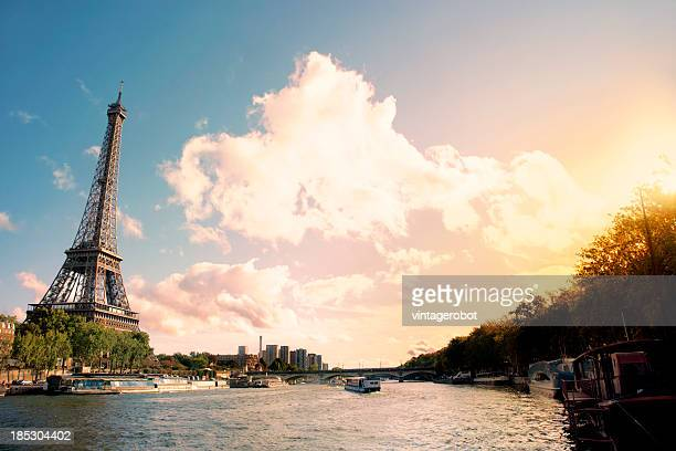 Eiffel Tower on the bank of river seine at sunset