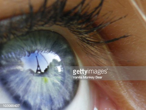 Eiffel Tower reflected in a girl's blue eye