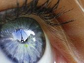 Eiffel Tower reflected in a girl's blue eye