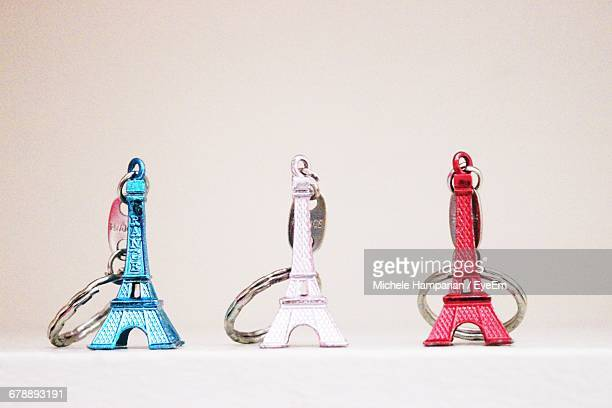 Eiffel Tower Shaped Key Chains Against White Background