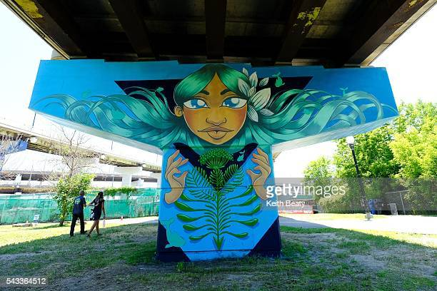 Eight artists are creating 'a love letter to the Don River' by creating permanent murals on the columns supporting the Don Valley Parkway ramp to the...