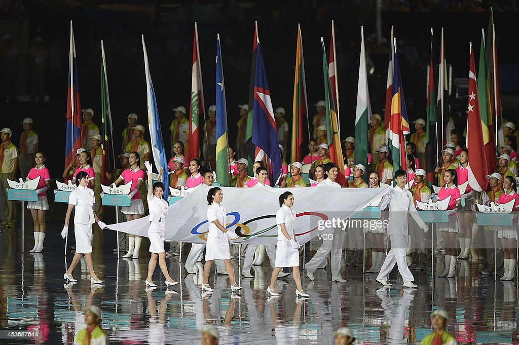 Eight athletes of China enter the stadium with the Olympic flag during the opening ceremony for the Nanjing 2014 Summer Youth Olympic Games at the Nanjing Olympic Sports Centre on August 16, 2014 in Nanjing, China.