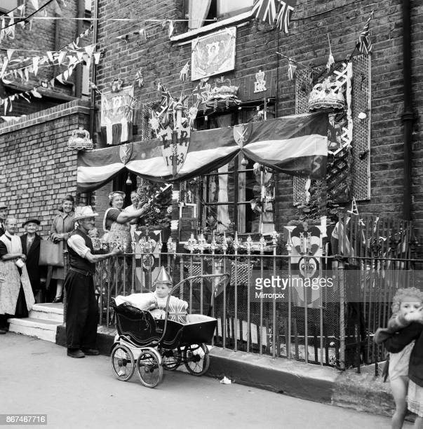 Eight days before Coronation Day on the Whit Monday bank holiday Decorations in Finsbury London 25th May 1953