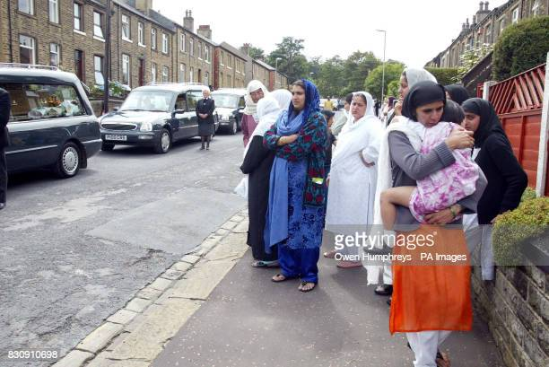 Eight hearses leave the street in Huddersfield where eight members of the same Asian family were killed in an arson attack Five young sisters died...
