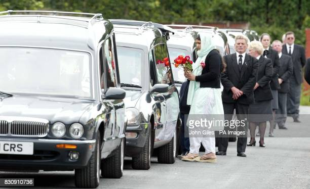 Eight Hearses leave the street in Huddersfield where eight members of the same Asian family were killed in an arson attack for a multi faith memerial...