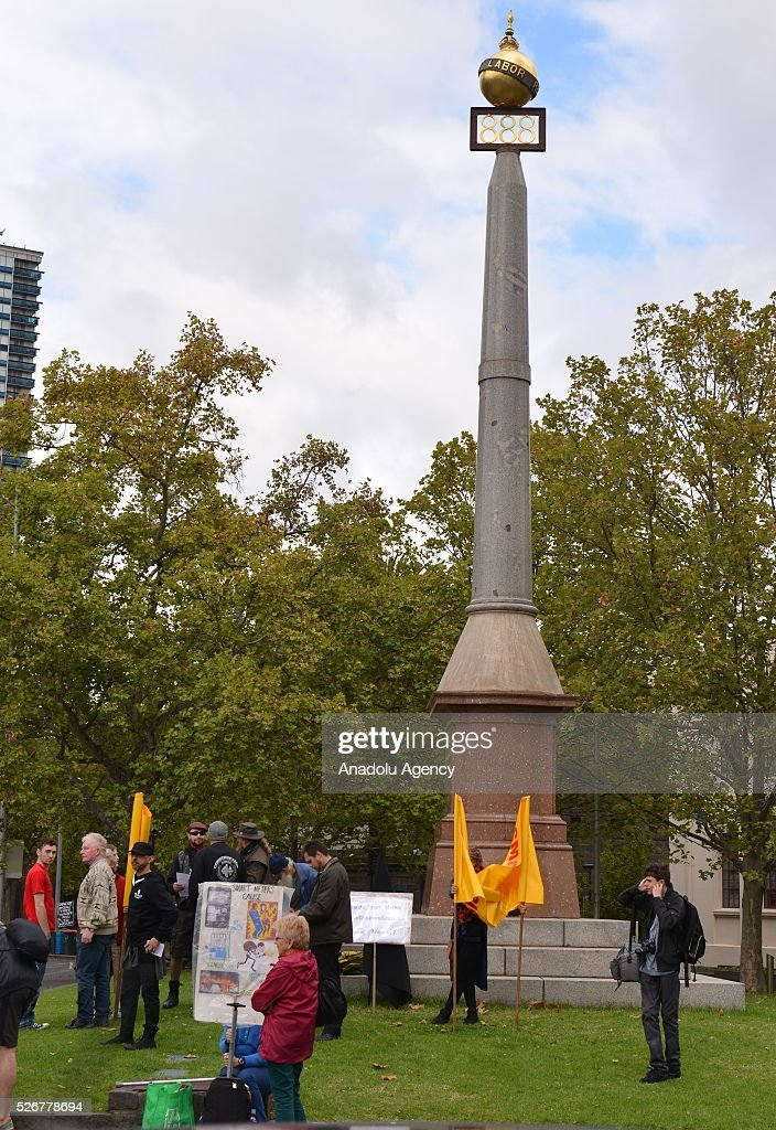 Eight Hour Day Monument is seen as demonstrators march towards city center during a rally to mark May Day, International Workers' Day, in Melbourne, Australia on May 1, 2016.