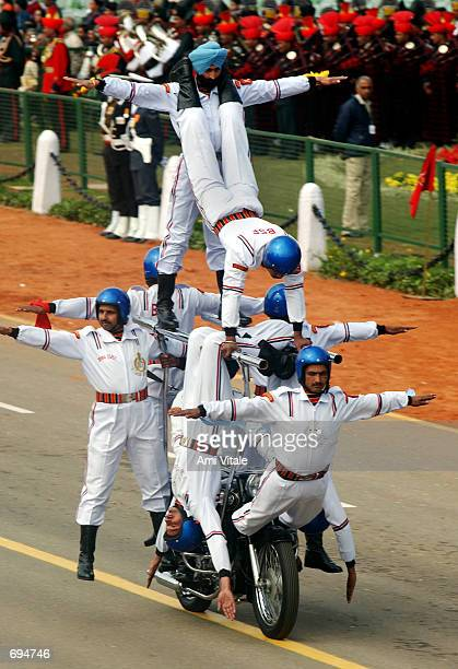 Eight Indian acrobats perform atop a motorcycle during the Republic Day Parade January 26 2002 in New Delhi India On Friday India tested a...