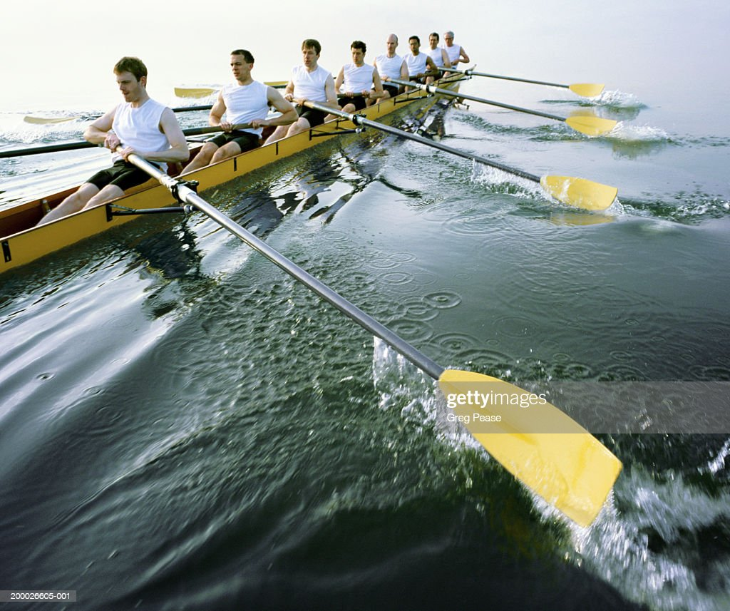 Eight man rowing team practicing (digital enhancement)