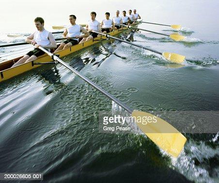 Eight man rowing team practicing (digital enhancement)