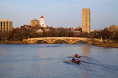 'Eight man sculls on the Charles River, late afternoon.'