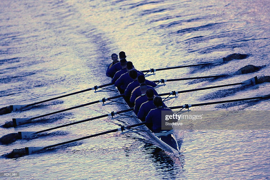 Eight men sweep rowing; coxswain in front of boat : Stock Photo
