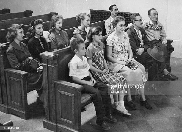 MAR 20 1957 MAR 21 1957 Eight of the 12 children of Mr and Mrs Rurrie Madison sit and watch court action in their $750000 suit against city Front row...