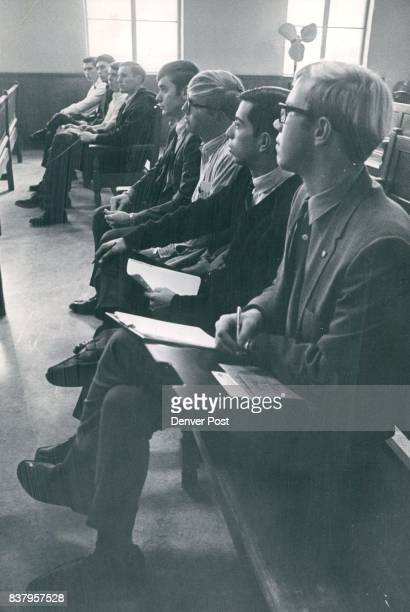 Eight of the 12 new police cadets listen at Orientation session in police building From left Gary S Osborn Milton Maier Erick Nelson David Hardin...