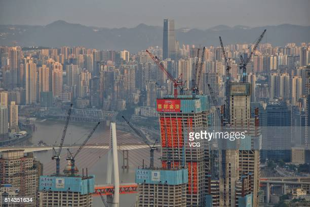 Eight towers of Raffles City Chongqing are roofed on July 13 2017 in Chongqing China Singapore property giant CapitaLand put down a $4 billion wager...