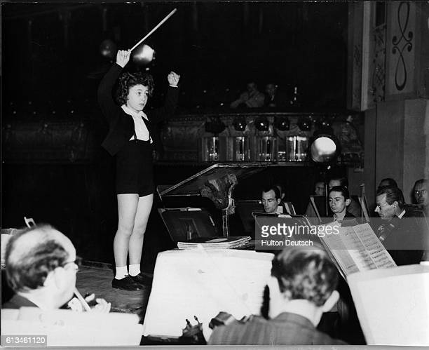 Eight year old boy Ferugio Burgo conducts the Concerts Colones Orchestra at the Chatelet Theater in Paris during a rehearsal