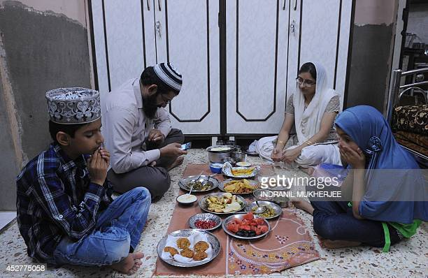 Eight year old Indian girl Noor Fatima waits to break the fast Iftar at her home in Mumbai on July 22 2014 Inspired by her elder brother fasting last...