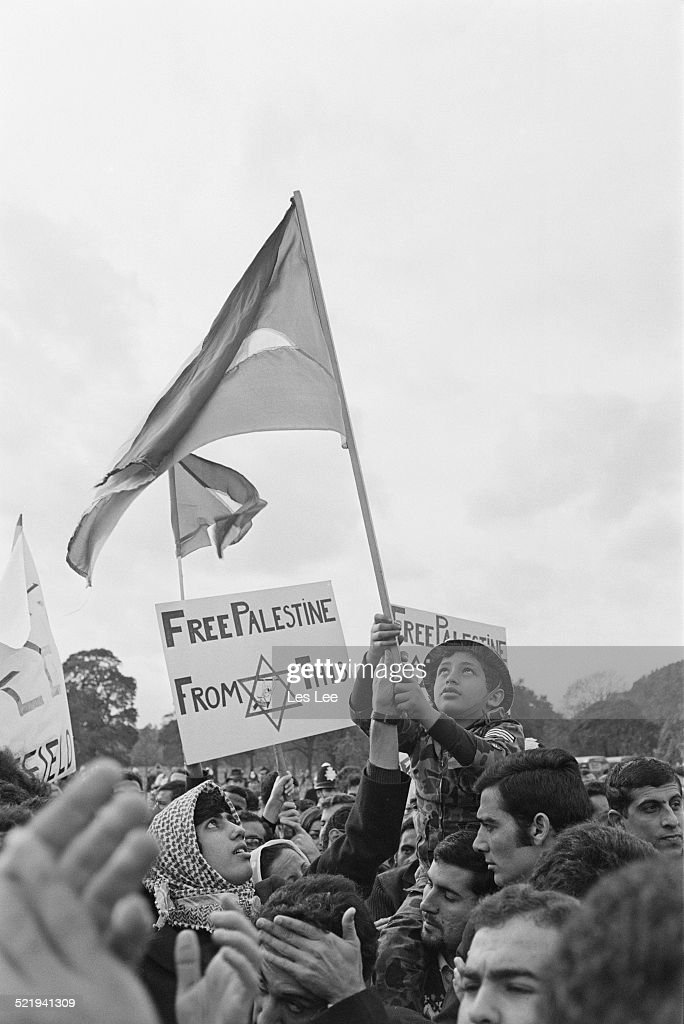 Eight year old Tariq Attia is hoisted above the crowd as Fatah supporters demonstrate against Israel 2nd November 1969