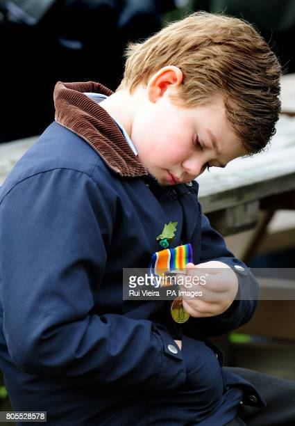 Eight year old William Wright from Ashbourne Derbyshire looks at his great grandfather's medals during Remembrance Sunday service at the National...