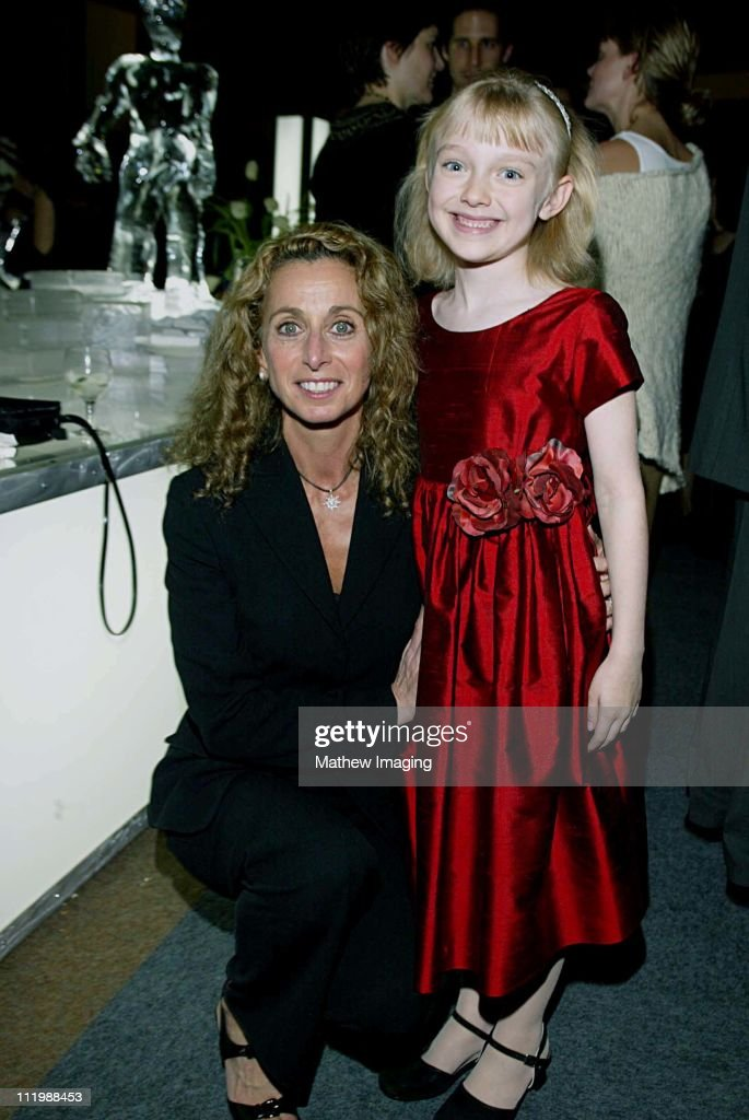 Eight year-old Dakota Fanning who is currently filming Dr. Seuss's Cat In the Hat has a major role in Steven Spielbergs Taken. The 20 hour mini-series premieres December 2, 2002 on the SCI FI Channel. Here Dakota poses with Bonnie Hammer.
