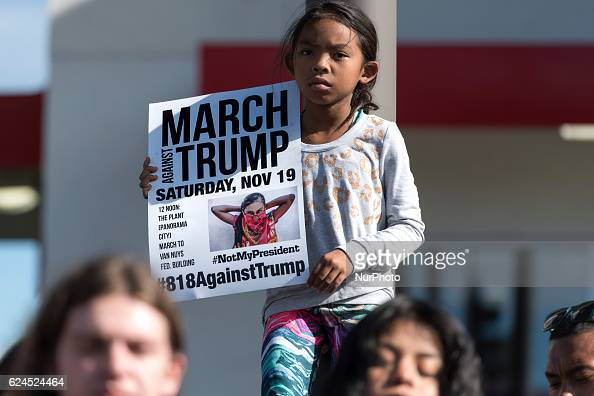 Eight yearold Olive Purnell holds a sign during an antiTrump protest in Los Angeles California on November 19 2016 Demonstrators from the San...