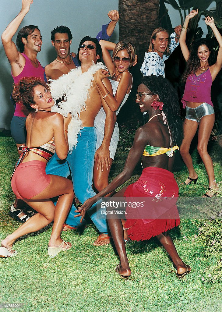 Eight Young People Dancing at a Party : Stock Photo
