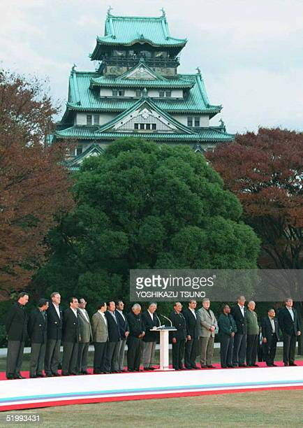 Eighteen APEC leaders line up with Osaka Castle as a backdrop as host Japanese Prime Minister Tomiichi Murayama delivers the final statement of the...