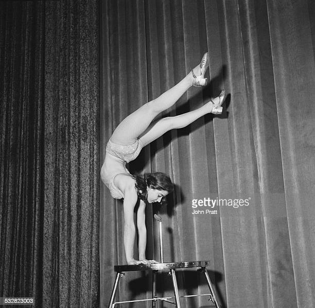 Eighteen yearold Austrian acrobat Eleonore Gunter standing on her hands during a performance October 1956