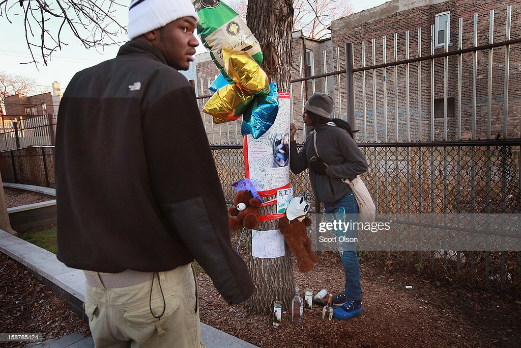 Eighteen-year old Samantha Boyd (R) and 19-year-old Marcell Carter sign a memorial to their friend, 16-year-old Jeffrey Stewart in the play lot where Stewart collapsed after being shot on December 9, in the Humboldt Park neighborhood on city's West Side December 11, 2012 in Chicago, Illinois. Stewart was shot about a block away then ran to the playground where he collapsed. Stewart was shot along with 17-year-old Anton Reed who survived with a gunshot wound to the hand. Reed was later arrested after vomiting three baggies of what appeared to be cocaine. On December 28, 2012, after news organizations began reporting about what was believed to be the 500th murder in Chicago this year, the Chicago Police Department's News Affairs Office issued a statement stating the city's murder total remains at 499 because classification of one death investigation remains pending. They would not specify which death is pending. The total number of murders in the city has only once exceeded 500 victims since 2004. The murder rate is up about 11 percent from 2011, much of which is attributed to growing gang violence.