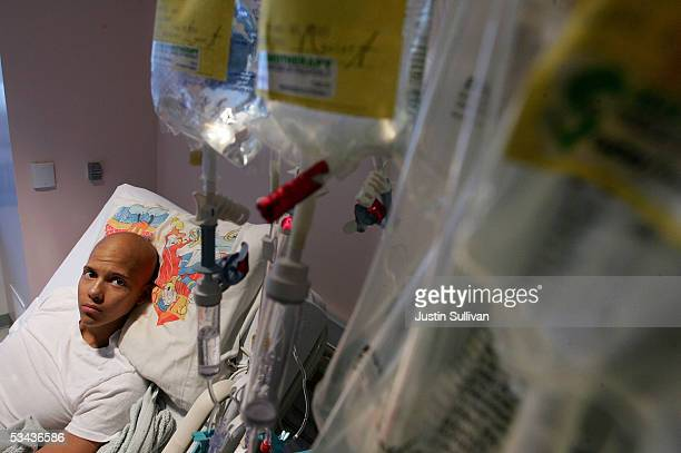 Eighteenyearold cancer patient Patrick McGill looks at a rack holding bags of IV chemotherapy while receiving treatment for a rare form of cancer at...