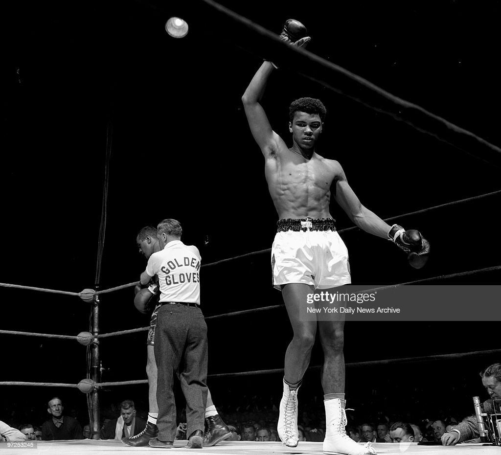 Eighteenyearold Cassius Clay raises his arm in victory after knocking out Gary Jawish in the 1960 Intercity championships at Madison Square Garden