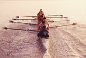 Eight-man crew team rowing, elevated view