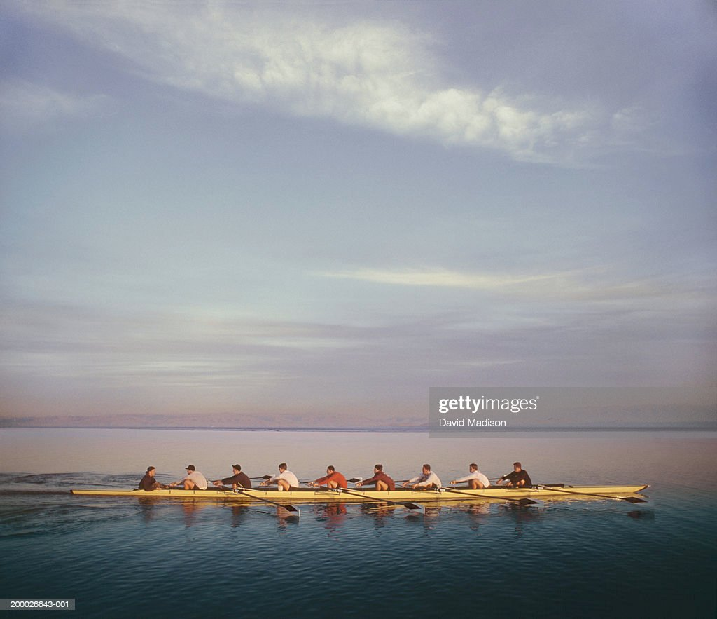 Eight-man crew team rowing, side view (digital composite) : Stock Photo