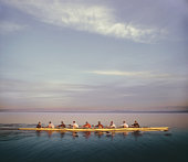 Eight-man crew team rowing, side view (digital composite)