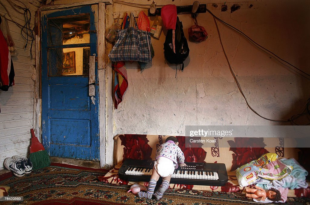 Eight-month-old Roma refugee Sabit plays on a keyboard in her family's house in the Cesmin Lug refugee camp in the Serbian district December 12, 2007 in Kosovo province, Serbia. One hundred and fourty-four refugees live in the camp near toxic metal waste left by the Trepca mines, living in extremely poor conditions with no running water. Members of the Roma minority were forced to flee their homes in the Mahala district in southern Mitrovica during the Kosovo war in the 1999. They settled in the Serb-populated northern side of the divided province. Were independence to come to Kosovo, the north would continue as a Serbian enclave. Kosovo, administered by the United Nations since the 1990 conflict, is home to approximately 120,000 Serbs, who face an uncertain future should the province, with its majority Albanian population, become independent under a U.N. proposed plan.