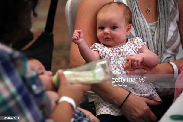 Eightweekold Eleanor Delp attends a 'What to Expect' baby shower with her mother August 21 2012 in Springfield Virginia The DC Metro Chapter of...