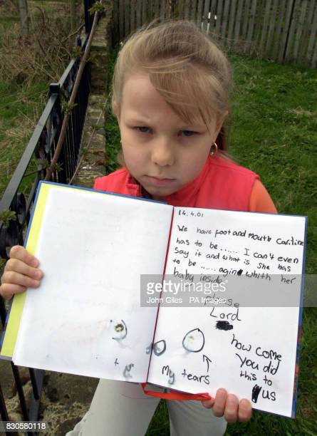 Eightyearold Jessica Cleminson at her home in West Auckland County Durham holds a page from her diary showing her heartache Jessica ringed her tears...